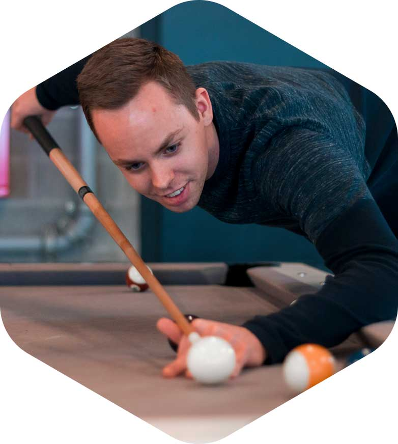 Developer playing a game of pool during lunch right image