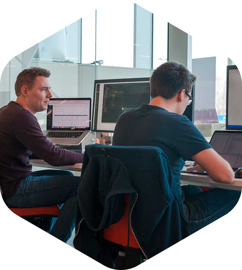 Frontend and backend developer working in the software delivery center left image